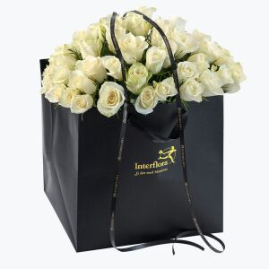 60 White Roses in a giftbag